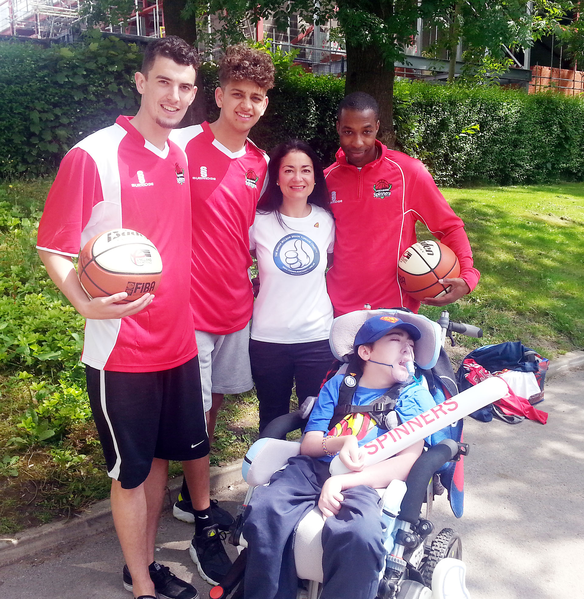 CHARITY NIGHT Conor Porter, Jalees Siddiq and Steven Gale with Joshua Wilson and his mum Dawn