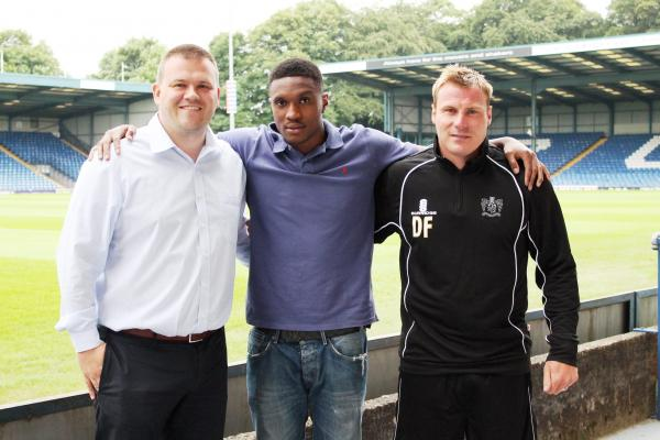 From the left, Bury chairman Stewart Day, new signing Kelvin Etuhu and manager David Flitcroft