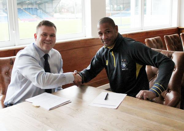 Clive Platt, right, signs a new Shakers deal with Bury chairman Stewart Day