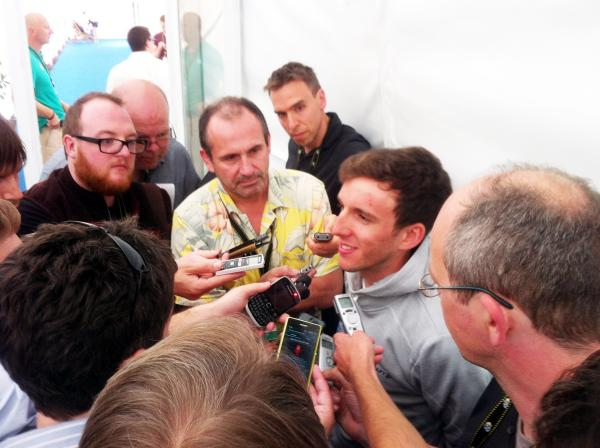 Simon Yates deals with the media scrum on the Tour de France