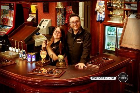 Paul Humphreys and Carla Wilson behind the bar at the Rovers Return