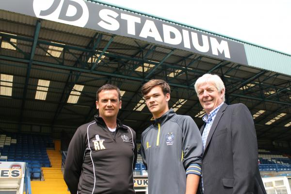 New Bury signing Jack Ruddy, centre, with youth team manager Ryan Kidd and director of youth Ian Kendall