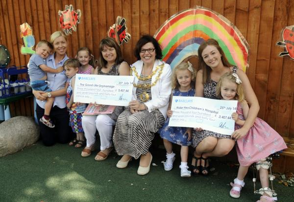 From left, Albie Robinson, aged two, Sarah Mather, nursery manager, Rocco Pritchard, aged four, Aimee Noone, aged four, Mary Maguire, founder of Good Life Orphanage, Mayor of Bury, Cllr Michelle Wiseman, Ellie Denney, aged five, Sally Denney and Molly Den