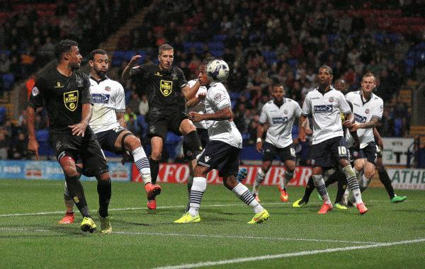 Bury captain Jim McNulty heads their second goal in Tuesday night's 3-2 defeat at Bolton