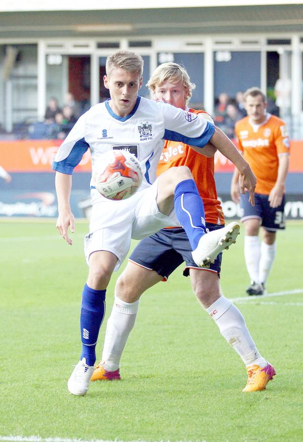 Danny Rose shields the ball from Luton's Scott Griffiths