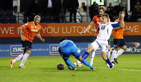 Danny Rose gets a toe to the loose ball to stab home Bury's opener at Luton