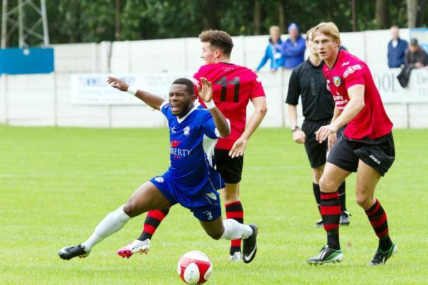 SENT FLYING Rams new boy Osebi Abadaki takes a tumble against Nantwich Pictures by Rob Moss