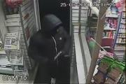 The armed robber raiding Khan's off-licence in Dumers Lane, Radcliffe