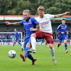 Bury Times: Billy Clarke challenges Rochdale's Tom Kennedy