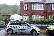 Police outside the house in Bury Road, Radcliffe, where Carole Bland was found stabbed to death.