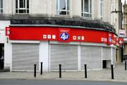 A Phones 4u store today with the shutters up