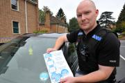 PC John Anyon with the innovative tax disc holder medical information card.