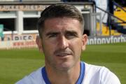 Ryan Lowe's late second goal for Bury sealed a 2-0 win in their final home game of the League Two season
