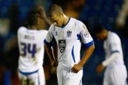 Bury's Joe Thompson had mixed emotions after playing for 45 minutes in Tuesday night's defeat at home to Tranmere