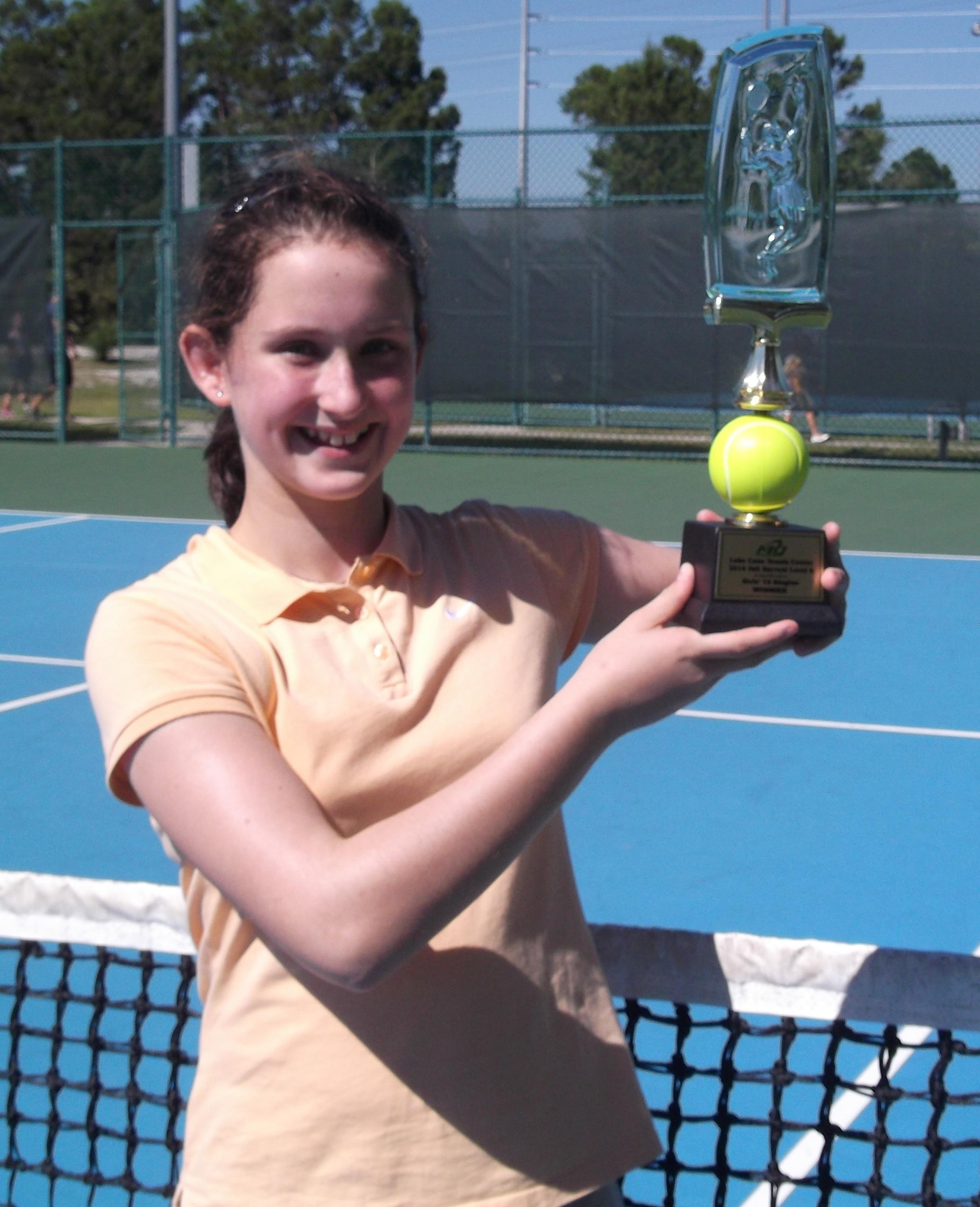 Natalie Flinn proudly displays her trophy after winning the Lake Cane Championships in Orlando, Florida