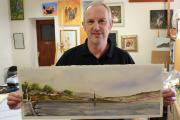 Steve Butterworth with his painting of Port Stanley