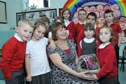 St Johns Primary Radcliffe Glenda Fletcher,a Lunctime Assistant who has been at St Johns for 20 years, is retiring  Picture by Richard Holton Newsquest(Bolton) ltd Copyright1st December, 2014Reporter and telephone number: Tui Benjamin  (14958040)