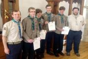 8th Prestwich Scouts Andrew Hayes, Ryan Davis, Thomas Porter, Jonathan McConville and Ben Tang, with explorer Scout leader David McConville, showing off their achievement certificates in 2013