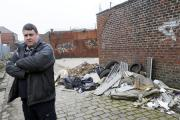 Mr David Mortimer, Owner of L&D Mortimer on Birch Street, Bury , who is pictuired next to some flytip rubbish. Image by Steve Holt, Bury Times, Tuesday March 17 2015. (20850371)