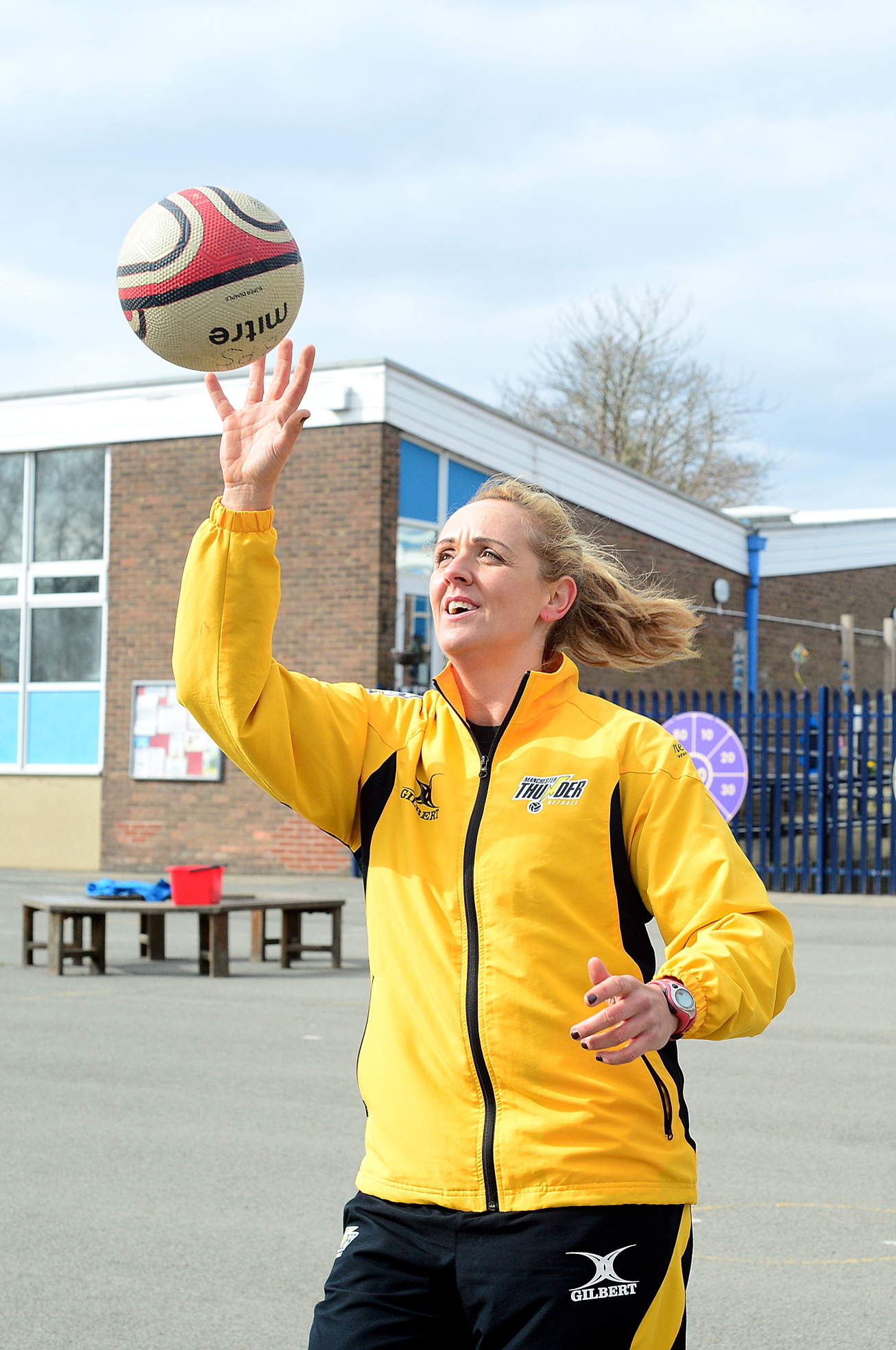 SCORE: England netball coach Tracey Neville teaches the pupils at Holcombe Brook Primary School in Ramsbottom, about netball
