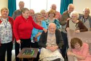 CENTENARY: James (front centre) and other Red Bank residents at the party