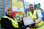 Dawn Taylor and Peter Allen with new heart difib placed outside ISM Waste on Kenyon Street, Ramsbottom.Images by Steve Holt, Bury Times, Friday May 22 2015. (26922799)