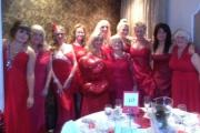 Some of the guests, dressed in red, during the event