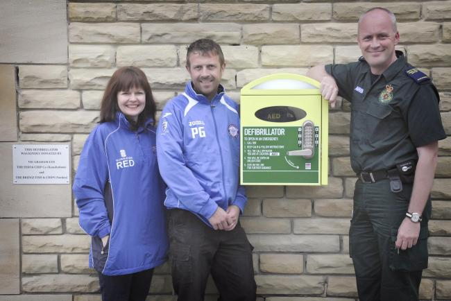 From left to right, Ruth Dowd, secretary Ramsbottom juniors Football Club, Paul Graham, under sevens coach and Steve Nicholls a paramedic and CPR and defibrillator training provider