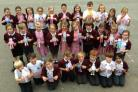 Holcombe Brook Primary School pupils with their 2D figures of themselves as world leaders with their 'If I were a world leader' messages