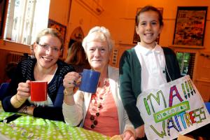 Children entertain teachers and family for charity coffee morning