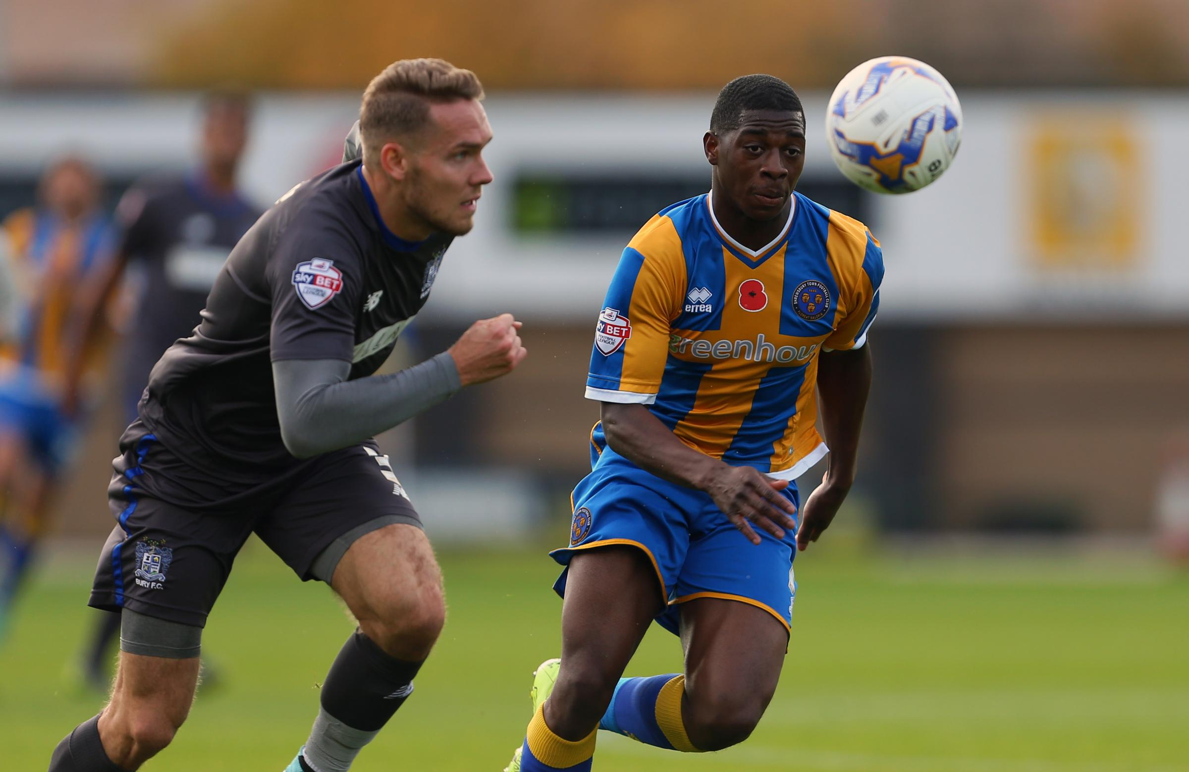 Chris Hussey, left, keeps tabs on Shrewsbury's Sullay Kaikai