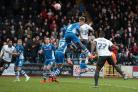 Danny Rose leaps high above the Rochdale defence to head home the only goal for Bury