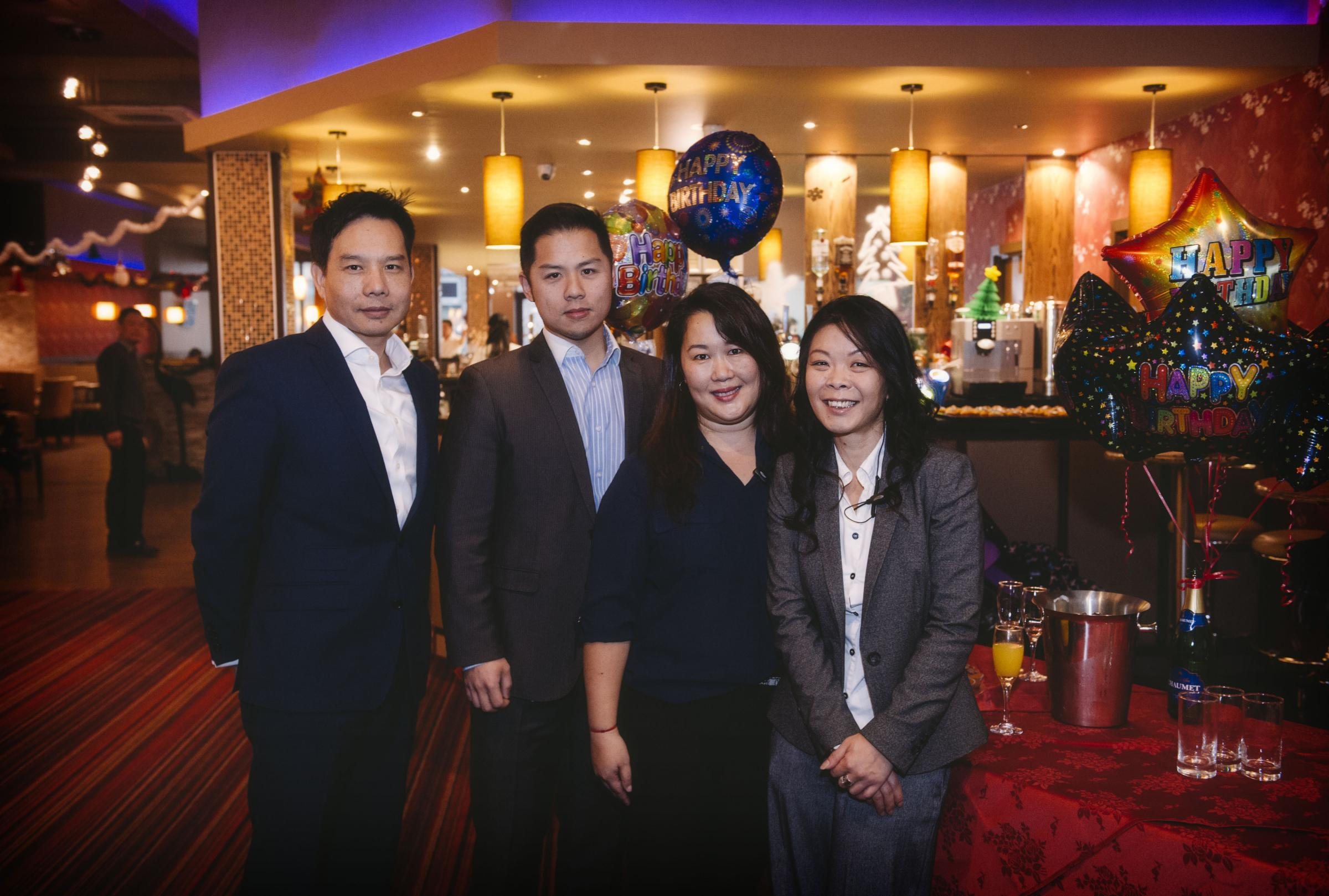 SUCCESS: From left, Paolo Hu and Peter Wu and from the Bury restaurant team, Sherry Chan and Eva Kam