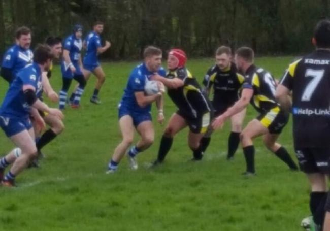 Bury Broncos, in blue, in action during their cup victory at home to Crosfields A