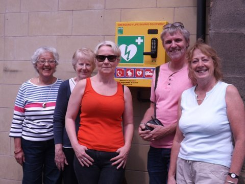 Members of Holcombe Society with the newly installed defibrillator