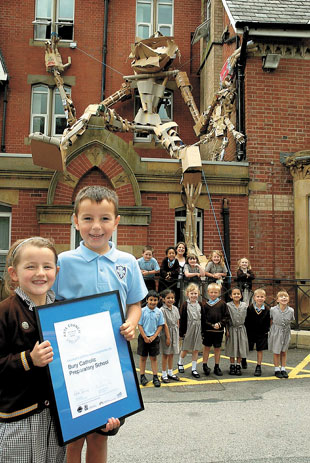 REACHING THE ARTS HEIGHTS: The 20ft sculpture, incorporating Bury Catholic Preparatory School's contribution, is pictured with some of the pupils of the school and teacher Elizabeth Gaskell. Pictured with the Artsmark gold award are (front) Emily Jones,