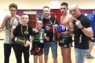 GFC fighters, from left,  Lewis Bentley, 11, Lewis George, age 11, and, second right, Kyle Schofield, age 17, with, fourth left, five-time world champion Andy Howson, of Science Of 8 Muay Thai, Birmingham, and chief instructor Darren Phillips