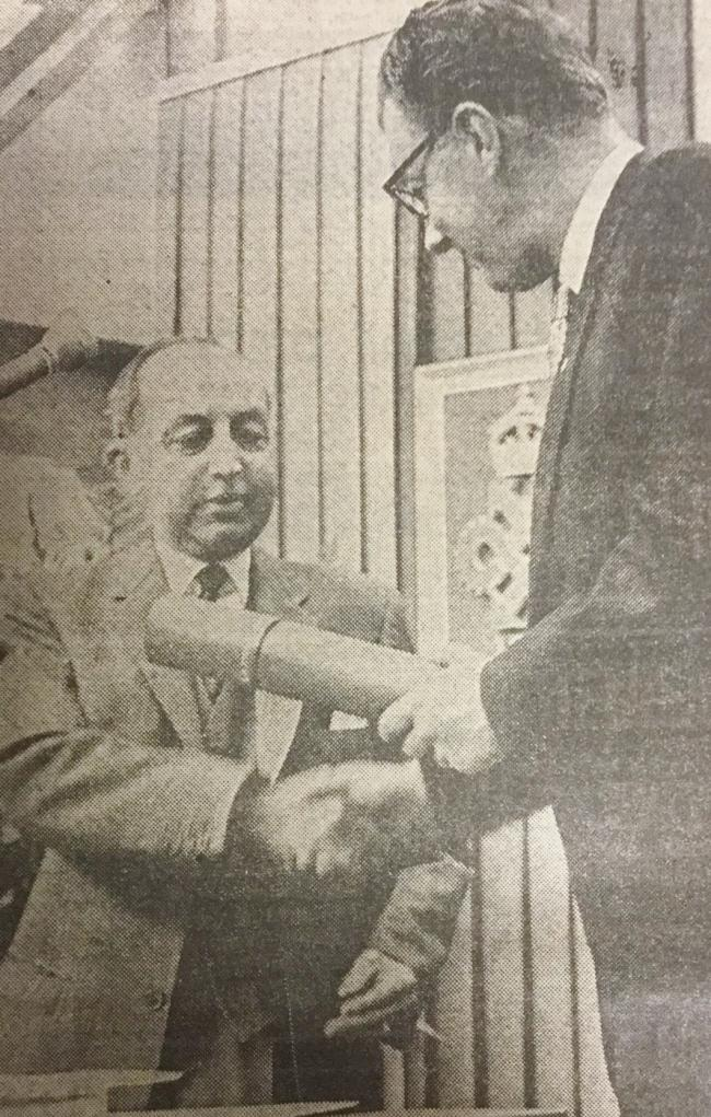 Thomas Dickinson recieves a Queen's Award from the Earl of Derby at the General Engineering Co. (Radcliffe) Ltd.