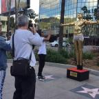 Bury Times: Gold statue of Kanye West as Jesus unveiled by British artist in Hollywood