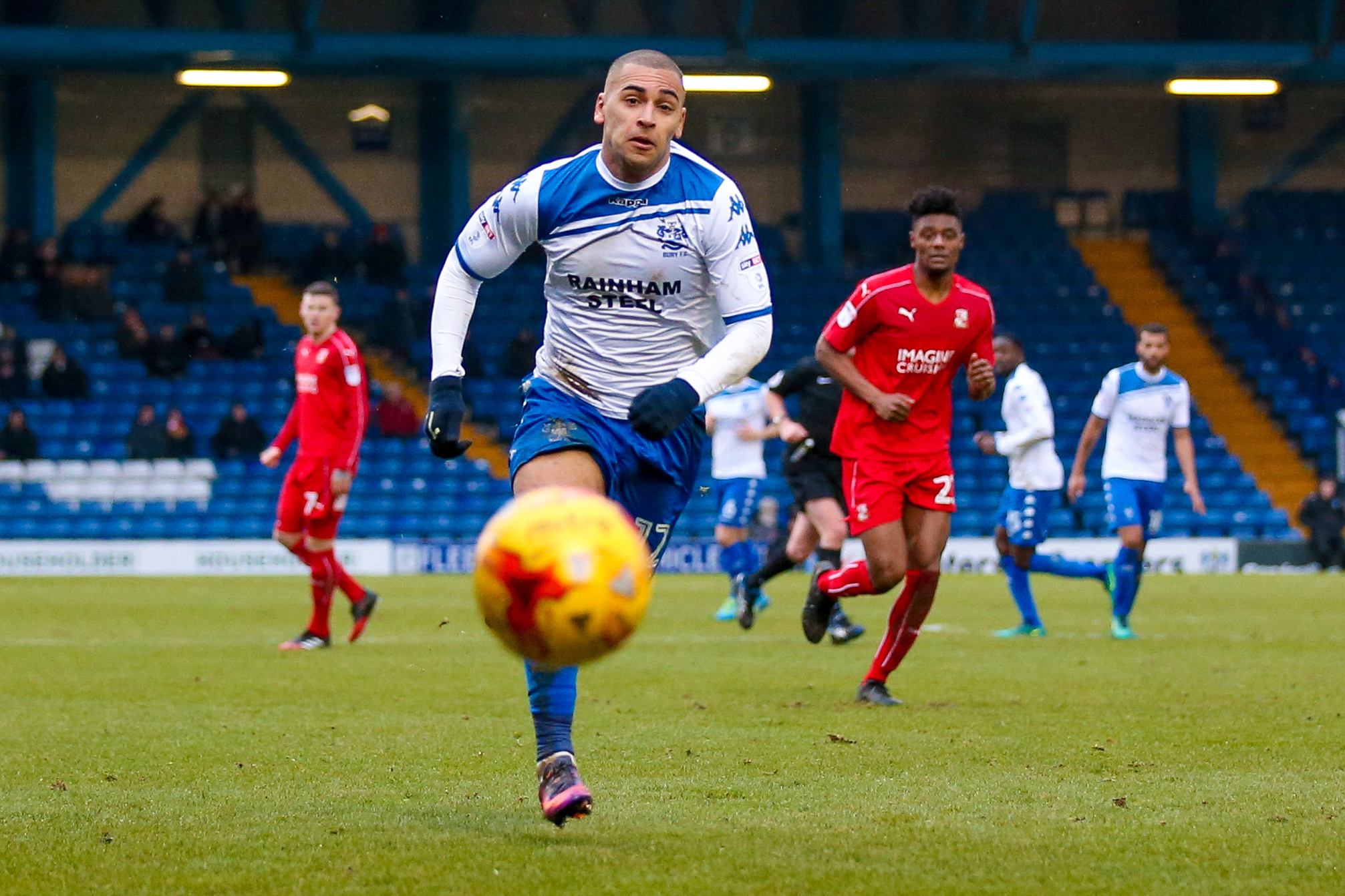Bury forward James Vaughan (12)  chases the ball down during the EFL Sky Bet League 1 match between Bury and Swindon Town at the JD Stadium, Bury, England on 11 February 2017. Photo by Simon Davies..