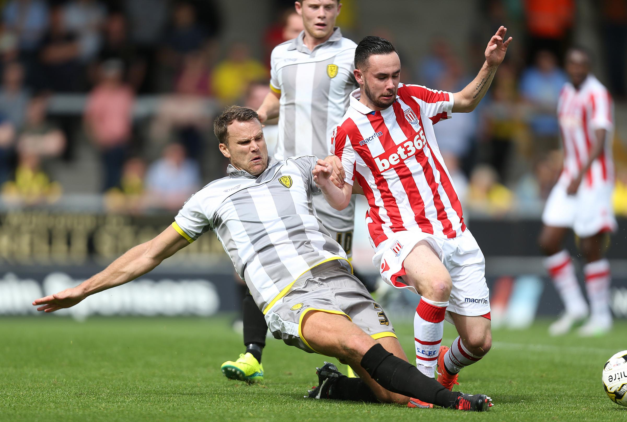 Callum Reilly, left, puts in a sliding challenge during a pre-season game last year between Burton Albion and Stoke
