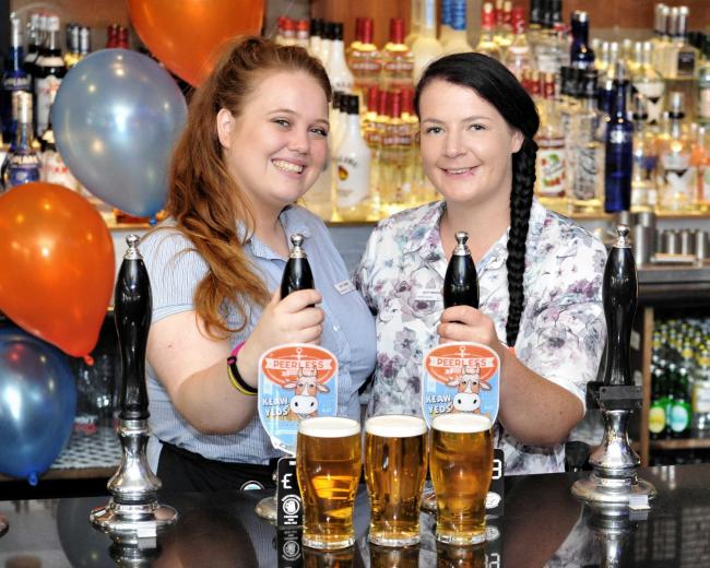 PINTS: The Robert Shaw shift manager Sheena Pyper-Mann, right, with shift leader Tasha Brady