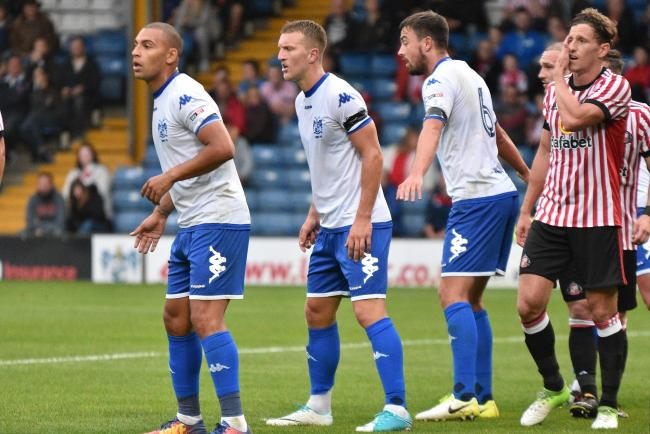 NOWHERE MAN: Bury have turned down another bid for James Vaughan, pictured, left, playing for Bury in Friday's 3-2 defeat at home to Sunderland