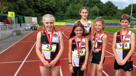 Young athletes, from left, Ella Hall, Erin Garroch, Daisy Worthington, Abigail Howard and Jay Cook at the Stockport Quadrathon