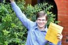 WHIZZ: Ryan Salter celebrates his A-level results at Holy Cross College, in Bury