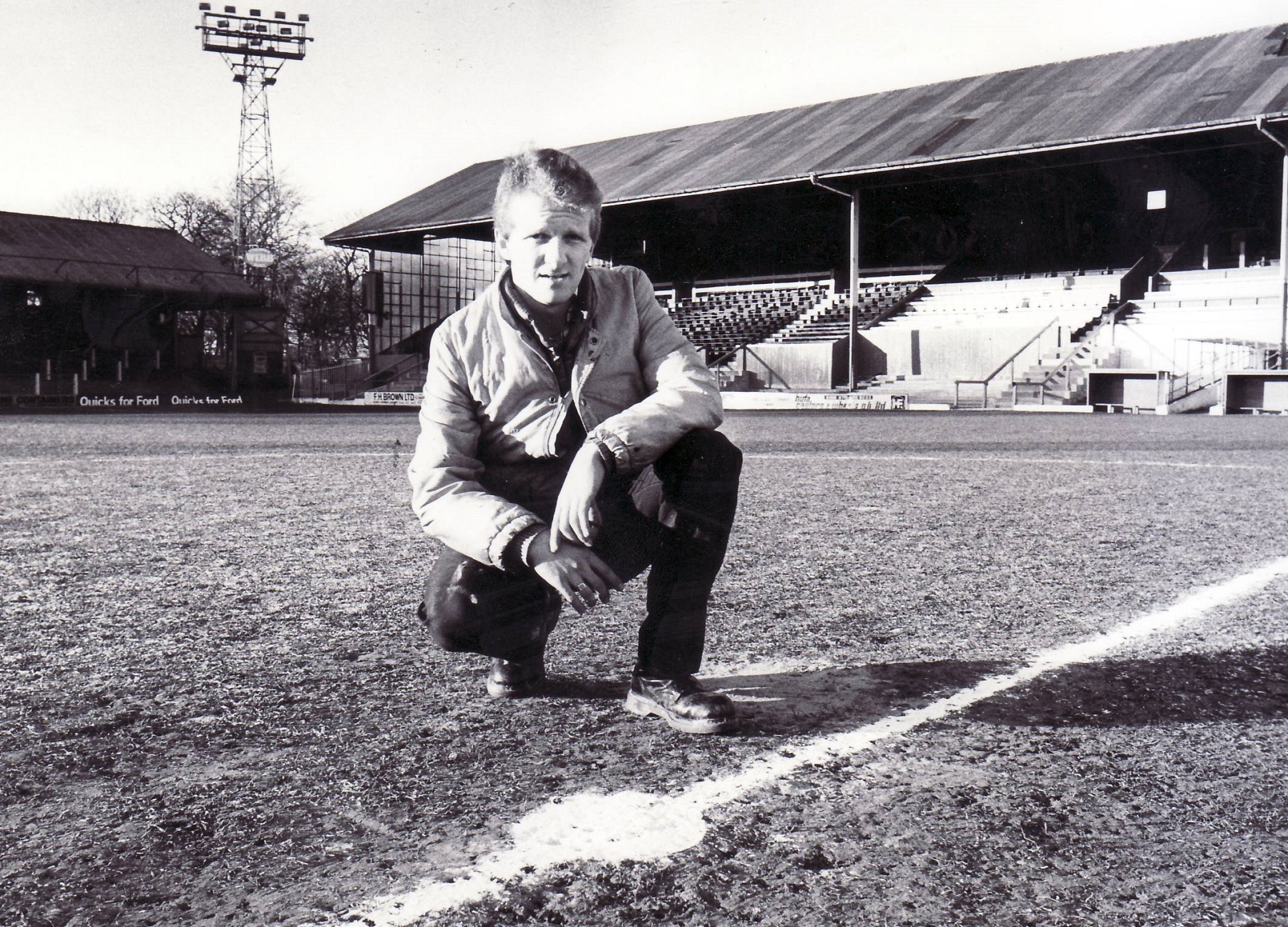 Rod Lester inspects a frozen pitch at Gigg Lane before the planned derby match against Bolton Wanderers on December 28, 1985