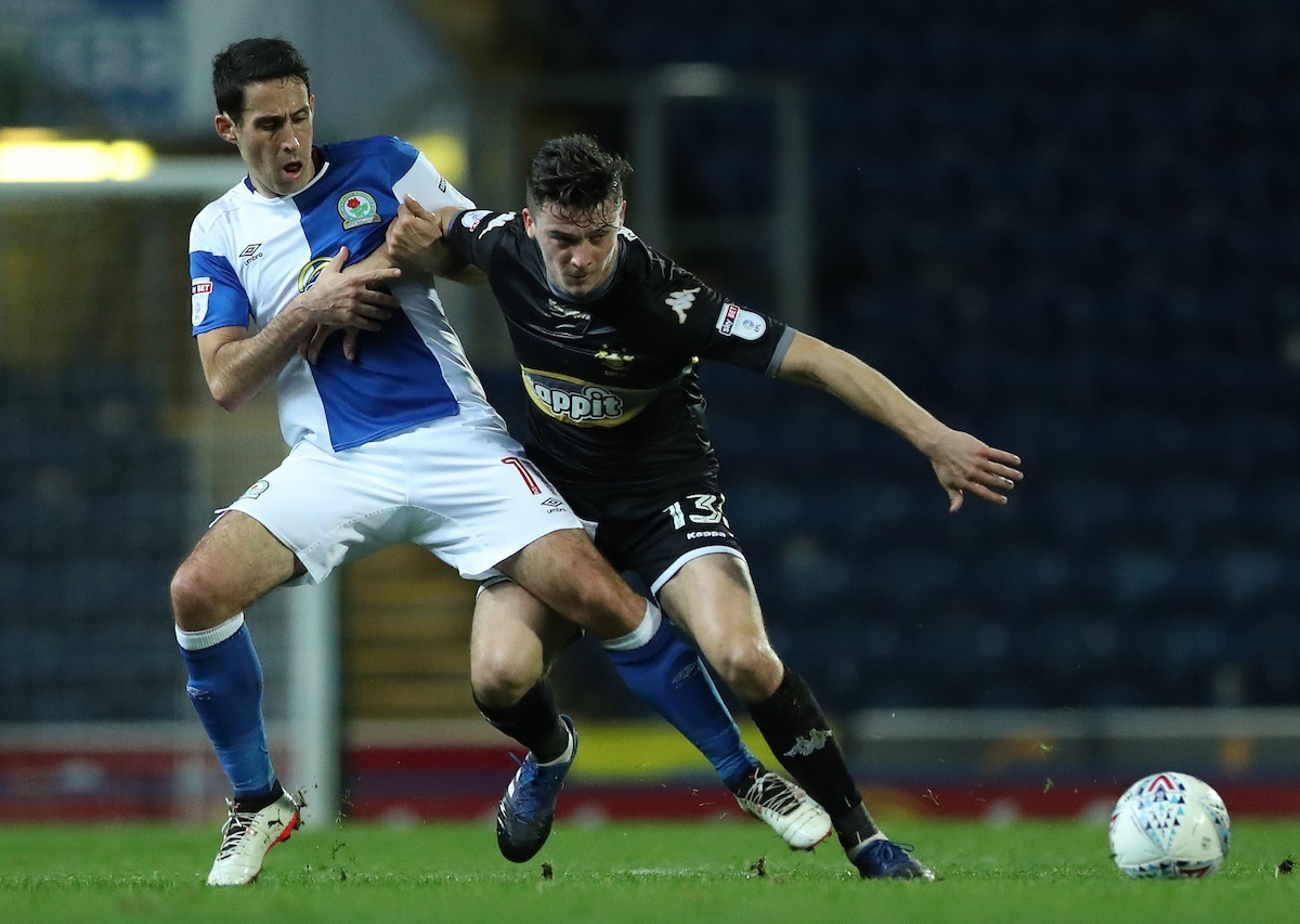 MY BALL: Bury's Callum Reilly holds off the challenge of Blackburn's Peter Whittingham at Ewood Park