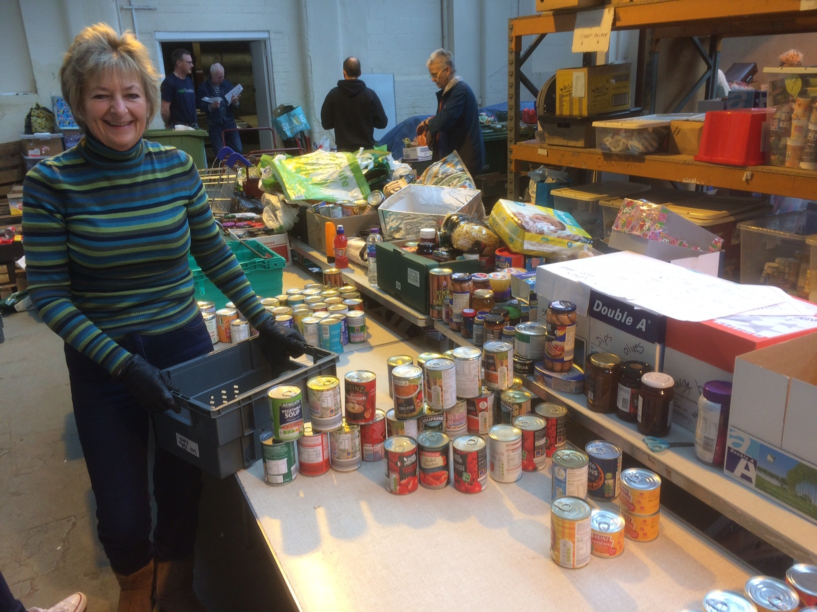 VOLUNTEER: Diane Gaunt packing crisis packs in the Porch Boxes headquarters