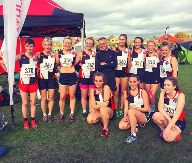 Members of the Bury team at the Red Rose Cross Country League meeting at Leigh Sports Village, standing, from left, Sophie Whittaker, Katie Geelan, Lauren Booth, Nicola Harland, Dave Cole, Christie Cook, Lizzi Cheshire, Caitlin Cole and Heledd Rimmer, kne