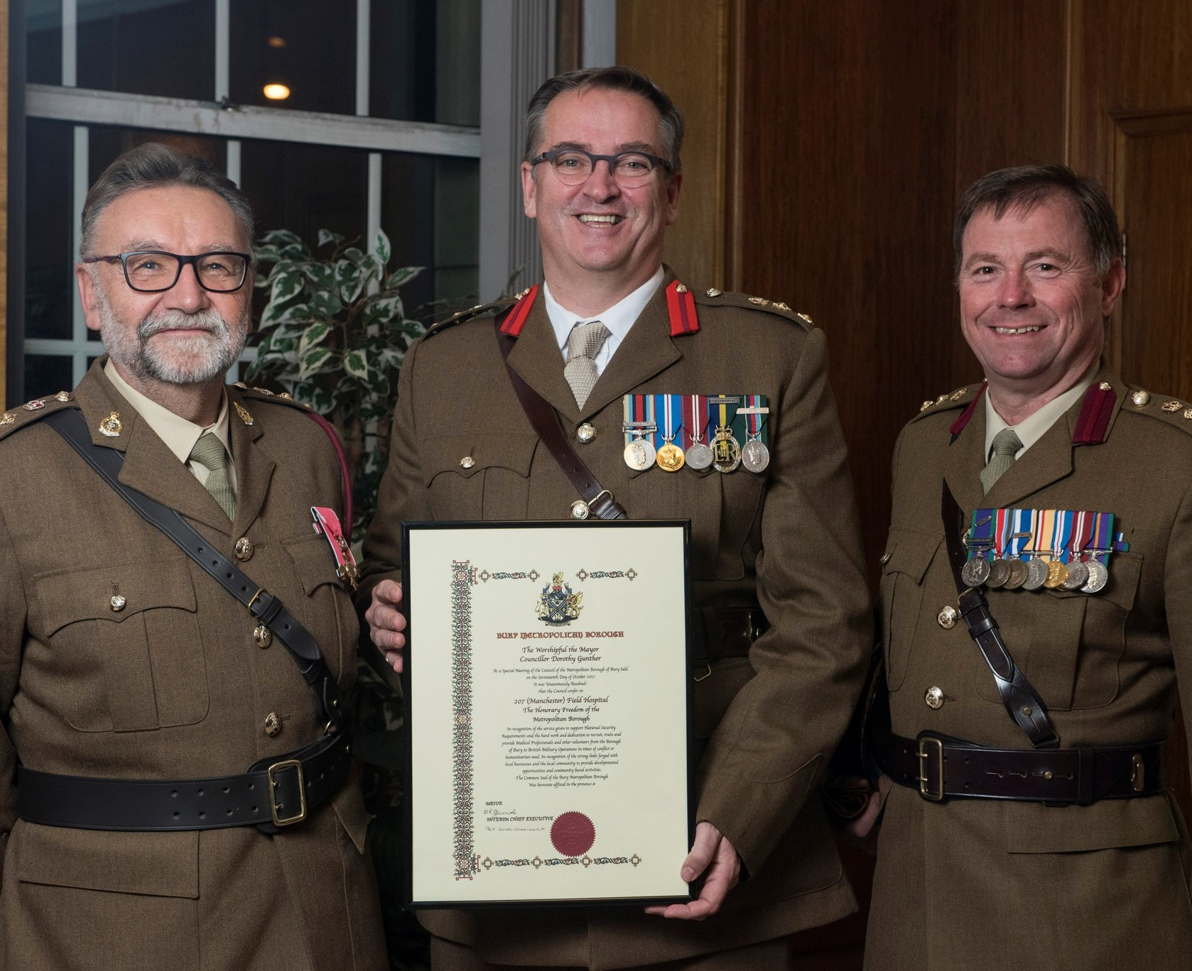 AWARD: Honorary Colonel Tony Redmond, Colonel Nick Medway and Colonel Phil Harrison